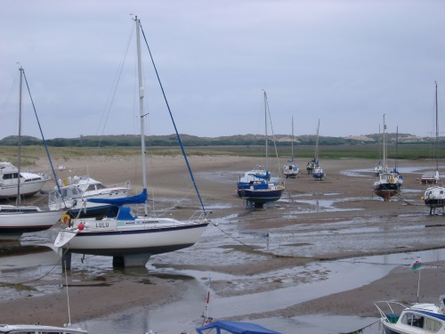 a tidal harbour full of yachts at low tide
